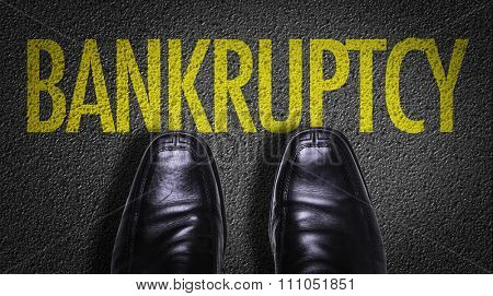Top View of Business Shoes on the floor with the text: Bankruptcy