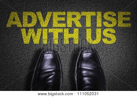 Top View of Business Shoes on the floor with the text: Advertise With Us