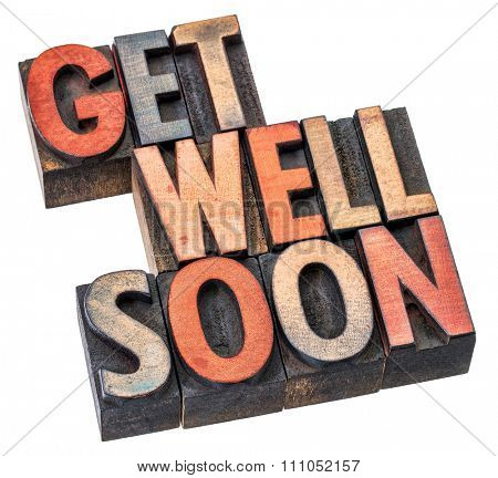 Get well soon wishes in letterpress wood type printing blocks stained by inks, isolated on white