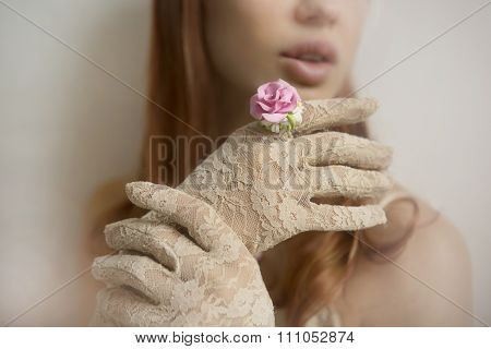 Romantic Vintage Style: Fashion Studio Shot Of Female Hand In Lace Gloves With A Rose Ring