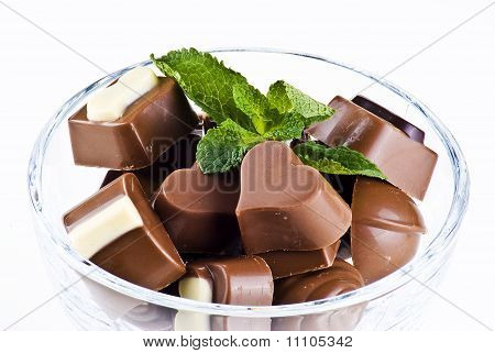 Glass Bowl Of Chocolates And Mint