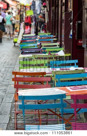 PARIS, FRANCE - SEPTEMBER 10, 2014: Paris - Very colorful Parisian outdoor cafe in Montmartre