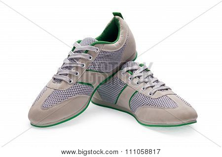 A Pair Of White Sports Shoes With Shoelace