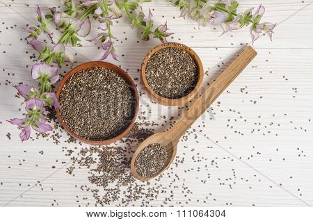 Chia Seed Healthy Super Food With Flower Over White Wood Background. Salvia Hispanica.