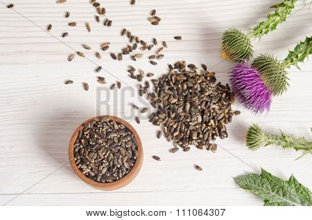 Seeds Of A Milk Thistle With Flowers (silybum Marianum, Scotch Thistle, Marian Thistle ) On Wooden T