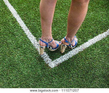Woman Legs On The Soccer Field