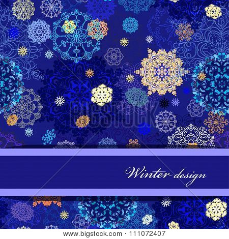 Winter design with golden and blue snowflakes on dark background.