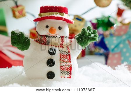 Snowman stand among pile of snow at silent night with a light bulb, light up the hopefulness and hap