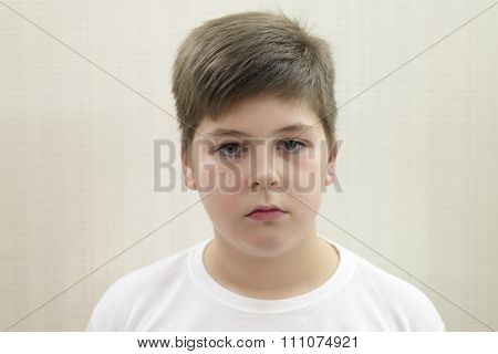 Portrait of  teenage boy on the background light walls