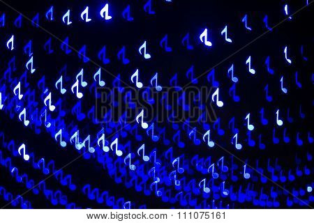 White, blue music note bokeh blur lights.