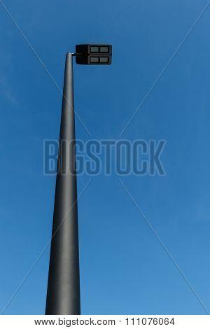 Modern Led Street Lamp Post Against A Blue Sky