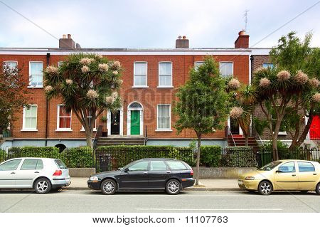 Cars Parked Near Two-story Red Brick House On Street In Dublin, Ireland