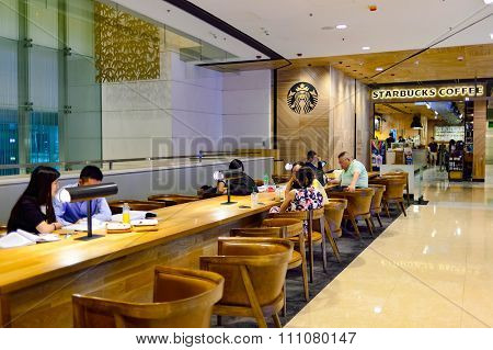 HONG KONG - MAY 5, 2015: Starbucks cafe in the IFC Mall. IFC Mall is a 800,000 sq ft, 4-storey shopping mall, with many luxury retail brands and wide variety of restaurants.