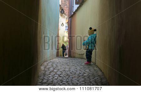 Alone sad child lost on a street