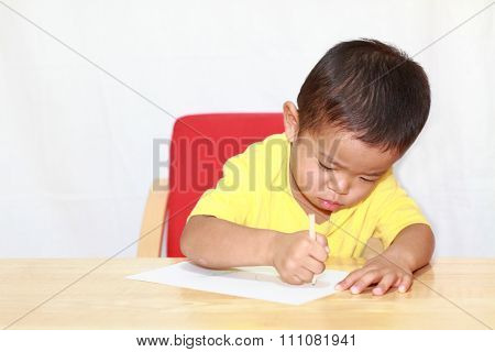 Japanese boy drawing a picture (3 years old)