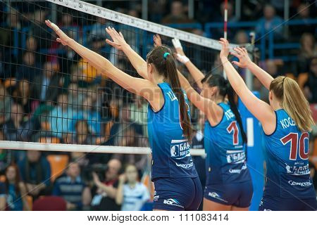 MOSCOW RUSSIA - DECEMBER 2, 2015: Unidentified players in action during the game on women's Rissian volleyball Championship game Dynamo (MSC) vs Dynamo (KZN) at the Luzhniki stadium in Moscow Russia. Kazan won in serie 3: 2