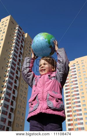 Little Girl In Pink Jacket Holds In Her Hands Above Head Balloon In Form Of Globe.