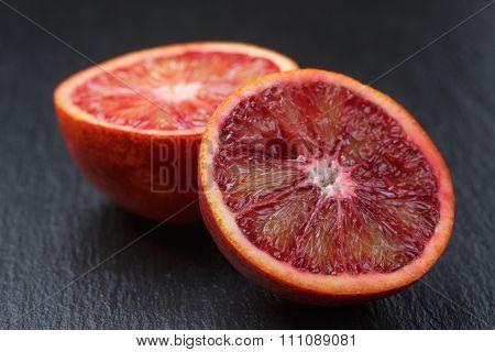 red sicilian oranges sliced on slate board