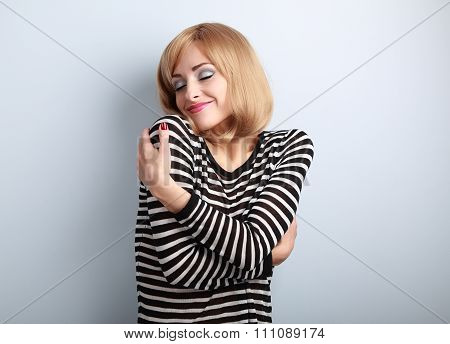 Happy Casual Woman Hugging Herself With Natural Emotional On Enjoying Face With Close Eyes