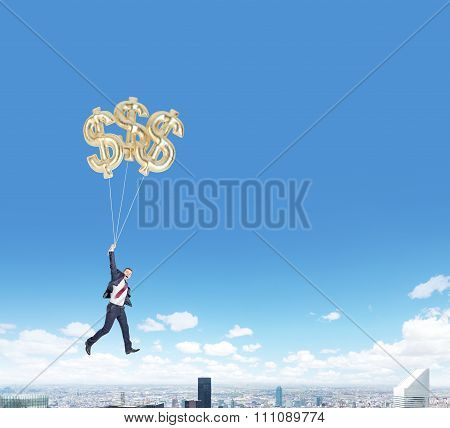 Man Flying With Dollar Balloons Over City