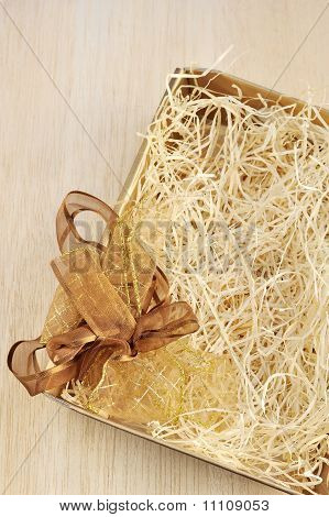 Open gift box and bow