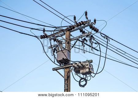 Transformer And Power Lines On Electric Pole On Sky Background