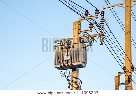 Transformer And Power Lines On Electric Pole With Sky Background