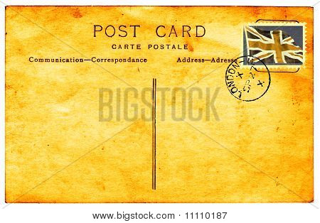 Genuine vintage postcard with postmark and faded and stained faux union flag stamp