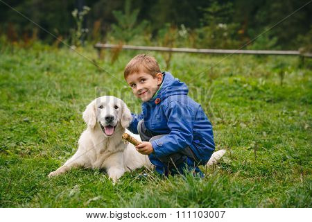 Boy with his pet in the forest
