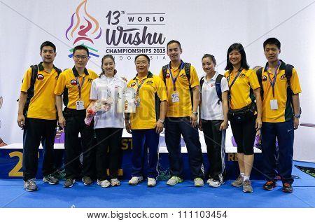 JAKARTA, INDONESIA - NOVEMBER 16, 2015: The Australian wushu team celebrates Elizabeth Lim's gold medal win in the women's compulsory nanquan event at the 13th World Wushu Championship 2015.
