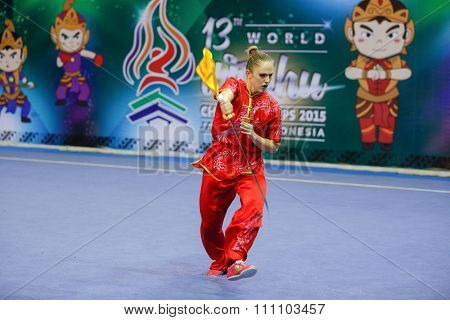 JAKARTA, INDONESIA - NOVEMBER 16, 2015: Rebecca Beuggert of Switzerland performs the movements in the women's Daoshu event at the 13th World Wushu Championship 2015 at the Istora Senayan Stadium.