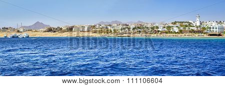 Lighthouse and hotel on the beach, Sinai, Red sea, Sharm El Sheikh, Egypt