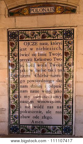 JERUSALEM ISRAEL - JULY 13 2015: Text of the Pater Noster prayer in Polish on one of the walls withi