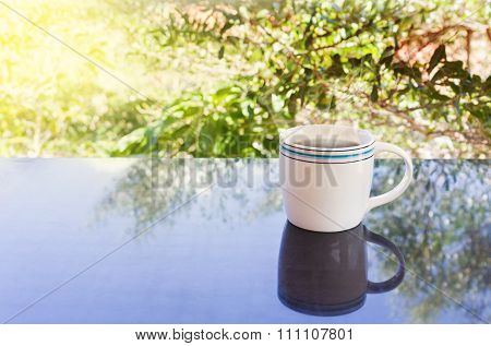 Classic White Cup Of Black Coffee  With Tree Background