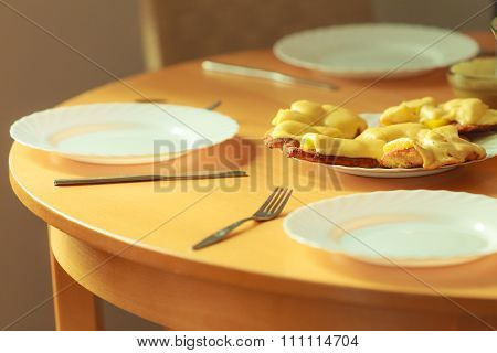 Chicken Cutlet With Pineapples And Cheese On Plate
