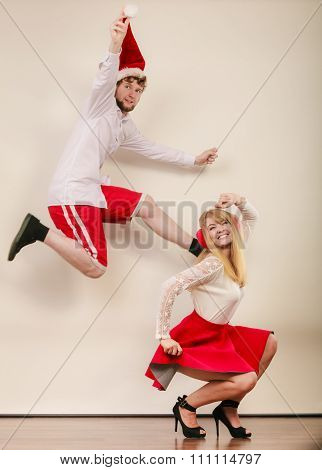 Happy Active Couple Dancing And Jumping.