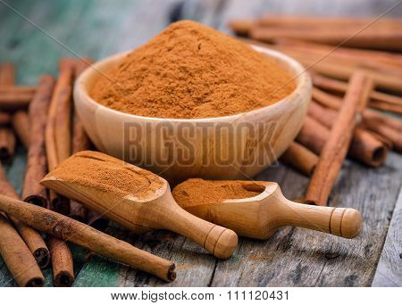 Cinnamon Sticks And Powder Cinnamon In The Bowl On Table