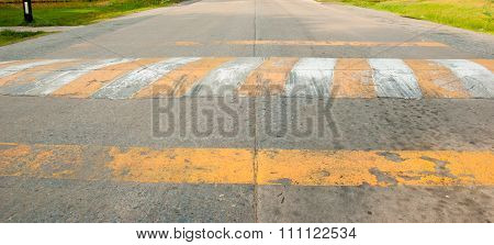 The Speed Bumps On The Road By White And Yellow Color