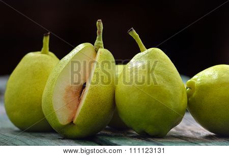 Green Pears On A Rustic Wooden