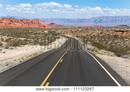 Winding Road In Colorful Desert Landscape