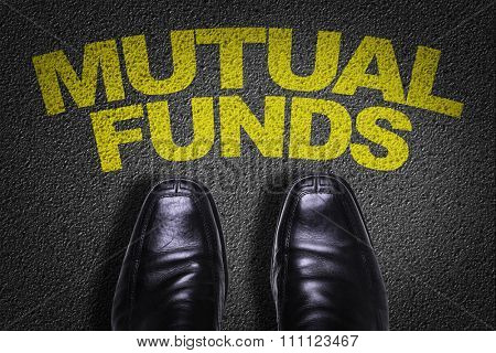 Top View of Business Shoes on the floor with the text: Mutual Funds