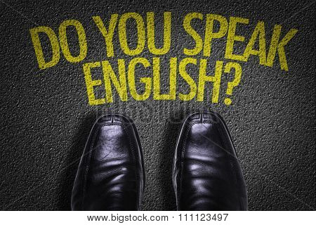 Top View of Business Shoes on the floor with the text: Do You Speak English?
