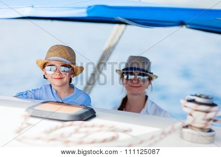 Mother and her daughter having great time sailing at luxury yacht or catamaran boat