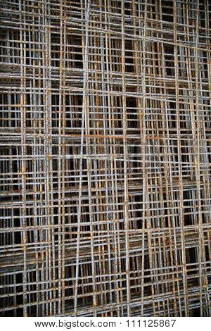 building, construction and material concept - close up of rusty carcass grid