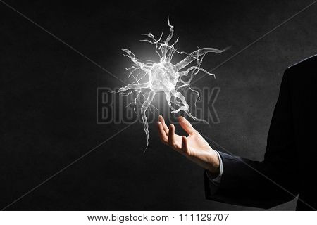 Close up of man hand holding nerve symbol in palms