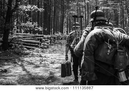 Unidentified re-enactors dressed as World War II German soldiers