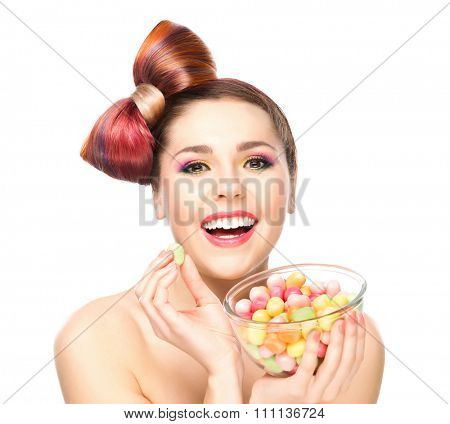 Attractive cheerful woman eating delights from a bowl.
