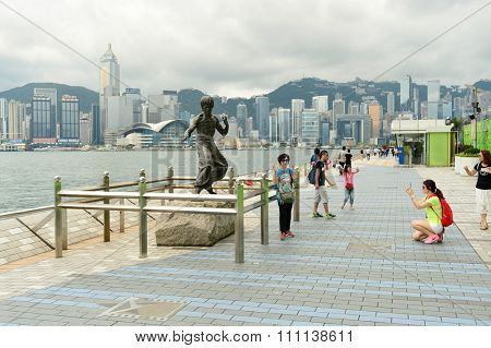 HONG KONG - MAY 06, 2015: Bruce Lee statue on The Avenue of Stars in Hong Kong. Avenue of Stars honours celebrities of the Hong Kong film industry.