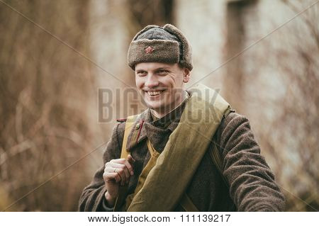 Smiling unidentified re-enactor dressed as Russian Soviet soldie