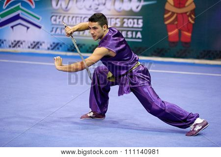 JAKARTA, INDONESIA - NOVEMBER 16, 2015: Jose Manuel Colmenero of Spain performs the movements in the men's Nandao event at the 13th World Wushu Championship 2015 at the Istora Senayan Stadium.